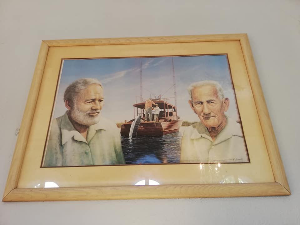 """Ritratto di Hemingway e Gregorio Fuentes alias Santiago ne """"il Vecchio e il mare"""". Vuisitare la casa di Hemingway a Key West"""